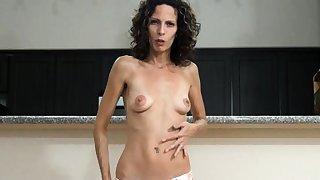 Well endowed grown-up brunette Kassandra goes solo