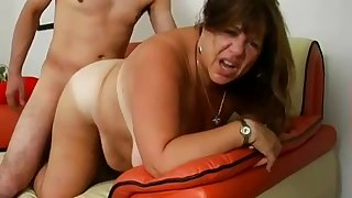 Tanned and heavy cougar gets white-headed boy up and fucked