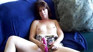 Mature amateur lady sucks cock coupled with uses a satisfying pink toy
