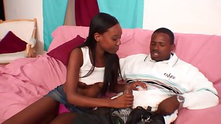 Ebony darling knows how to pleasure her boyfriend's black cock