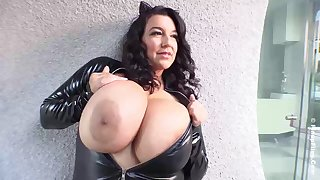 Shove around brunette in a tight, latex costume, Subrina Lucia is resembling us her massive milk jugs