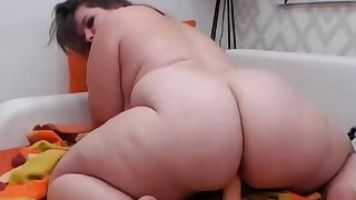 Horny BBW with huge ass fucks dildo